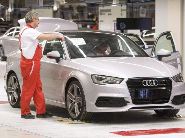 Audi employees work on an Audi A3 limousine on the assembly line at Audi's production site in Gyor, Hungary, 12 June 2013. The US Evironmental Protection Agency (EPA) on 18 September 2015 ordered Volkswagen to recall nearly half a million four cylinder diesel cars from both Audi and VW.