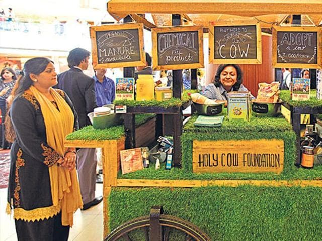 Anuradha Modi, founder of Holy Cow Foundation, at The Thela at Delhi's Select City Walk mall. She sells face packs, shampoos, soaps etc made using cow urine, dung, milk and milk products, and says her stall gets about 25 curious shoppers every day. (HT photo/ RAJ K RAJ)