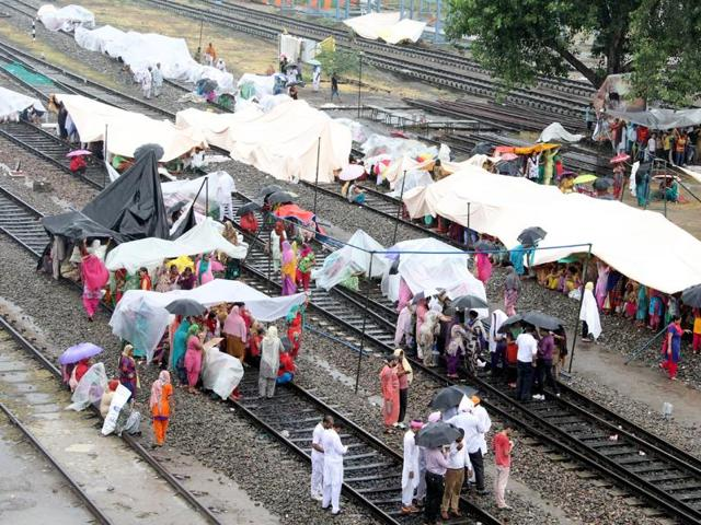 Undeterred by rains, Dera Sacha Soda followers blocked rail tracks at Bathinda on Sunday.