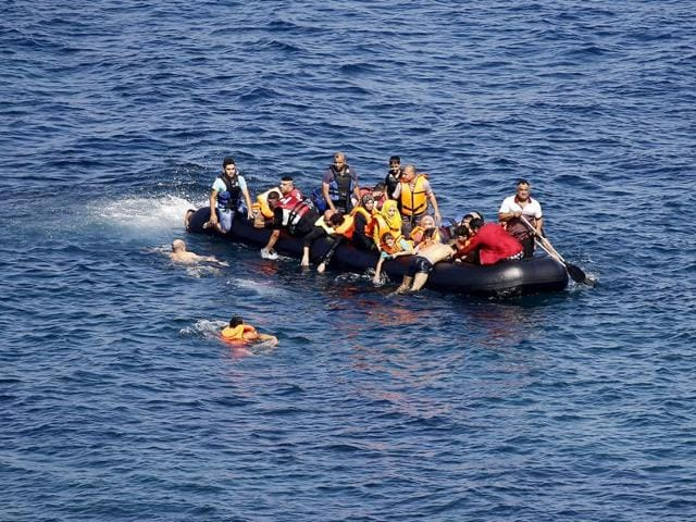 A dinghy overcrowded by migrants and refugees drifts out of control after its engine broke down while crossing the Aegean Sea from Turkey to the Greek island of Lesbos September 20, 2015.