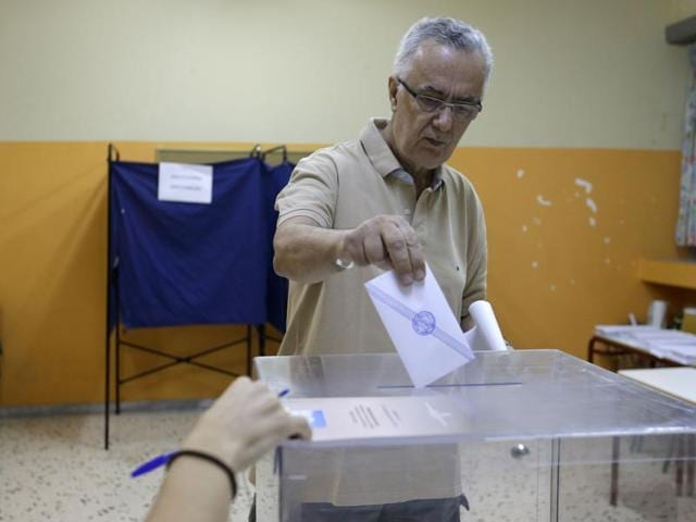 A man casts his vote at a polling station in Athens, Sunday.