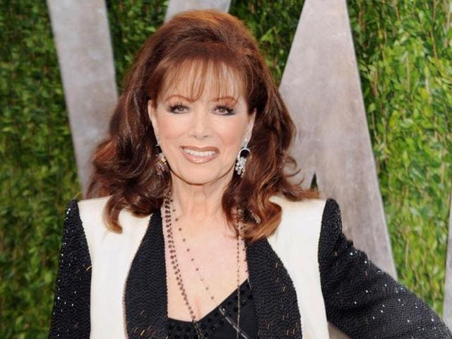 In this Feb. 24, 2013 file photo, author Jackie Collins arrives at the 2013 Vanity Fair Oscars Viewing and After Party in West Hollywood, California.