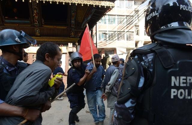 Nepalese police arrest a demonstrator during a general strike called by a hardline breakaway faction of former Maoist rebels (Communist Party of Nepal-Maoist) against the draft of the new constitution in Kathmandu on September 20,2015 even as the Himalayan nation adopted a new national constitution on Sunday.