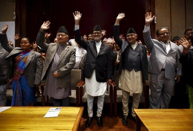 Nepal's Prime Minister Sushil Koirala (C), is seen along with other leaders after signing the copy of constitution at the parliament in Kathmandu, Nepal .