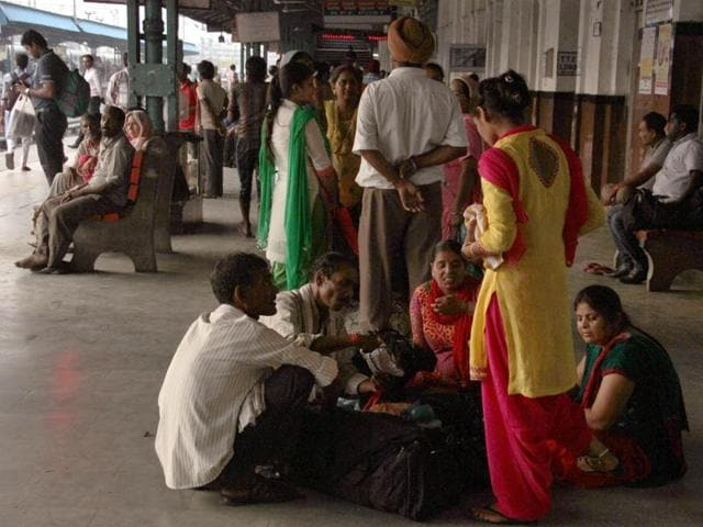 Harried passengers waiting at the Ludhiana Railway Station on Monday.