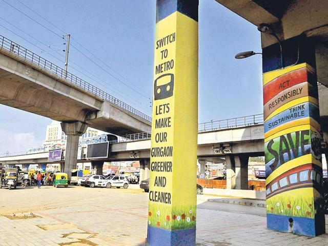 Graffiti, highlighting the importance of using public transport, painted on the pillars of the Sikanderpur Metro station.