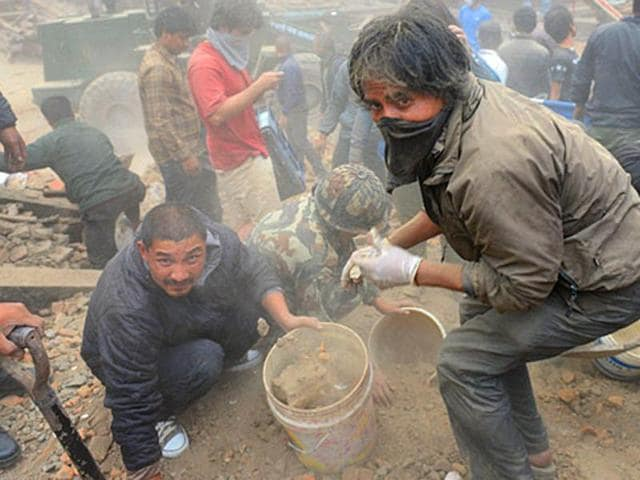 People clear rubble in Kathmandu's Durbar Square, a UNESCO World Heritage Site that was severely damaged by the earthquake in April.