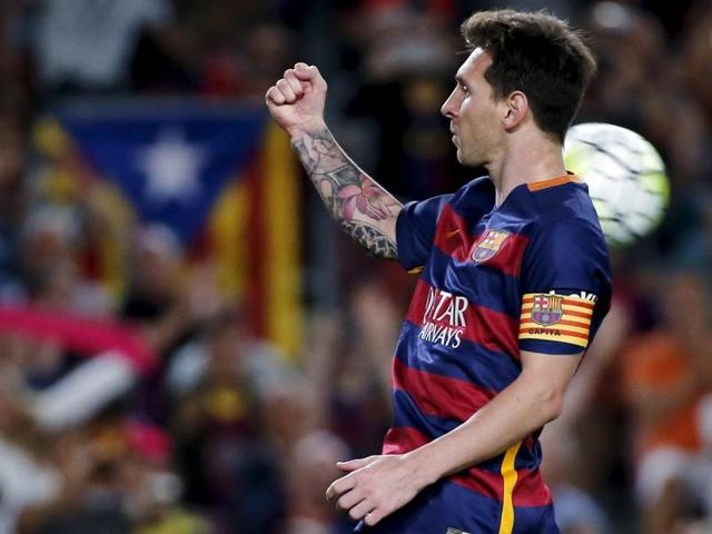 FC Barcelona's Lionel Messi celebrates after scoring off a penalty kick against Levante during their La Liga soccer match at Camp Nou stadium in Barcelona, on September 20,