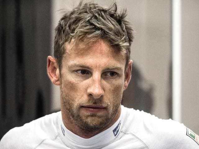 McLaren Honda's British driver Jenson Button in the garage during the free practice session ahead of the Formula One Singapore Grand Prix, on September 18, 2015.