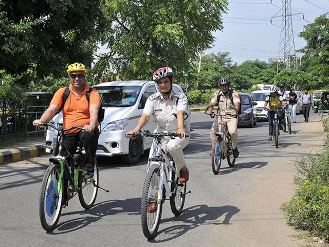 Bharti Arora, joint commissioner of police (traffic), rides a bicycle in Gurgaon on Tuesday.