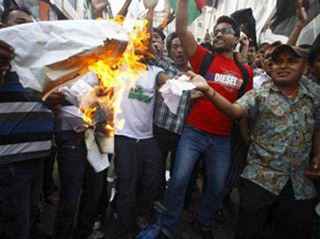 Supporters of opposition parties burn papers symbolizing Nepal's first democratic constitution during a protest against the constitution, in Kathmandu, Nepal.