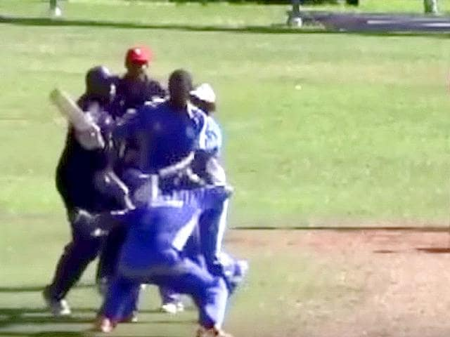Cleveland County Cricket Club's Jason Anderson in a fight with Willow Cuts Cricket Club's batsman George O'Brien during the Champion of Champions final at the St David's Cricket Club Ground.