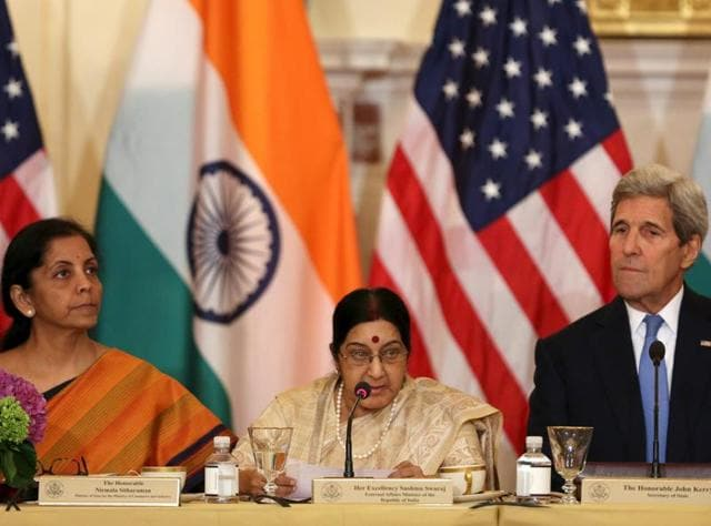 US Secretary of State John Kerry (R) listens to India's Minister of Commerce and Industry Nirmala Sitharaman (L) and External Affairs Minister Sushma Swaraj (C) at the US-India Strategic & Commercial Dialogue plenary session at the State Department in Washington September 22, 2015.