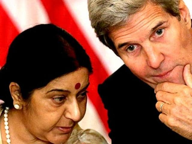 US secretary of state John Kerry chats with Indian external affairs minister Sushma Swaraj at the US-India Strategic & Commercial Dialogue plenary session at the State Department in Washington.