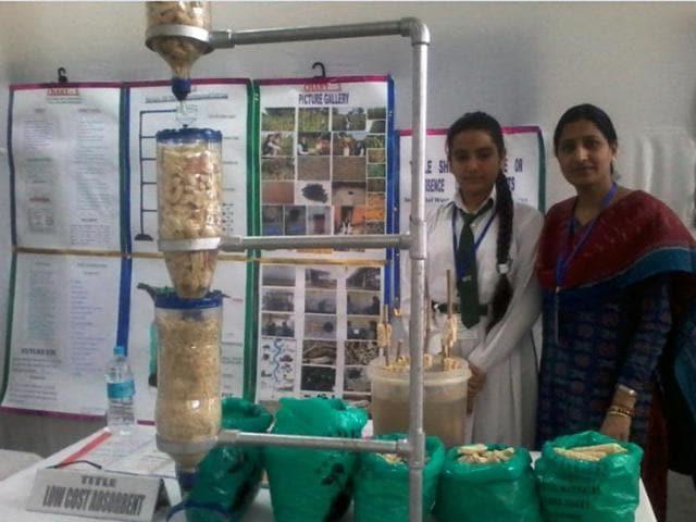 Lalita Prasida Sripada Srisai with a corn farmer in Koraput. Srisai won the Community Impact Award of Google Science Fair on Tuesday for her project of using corn cobs as water purifier.