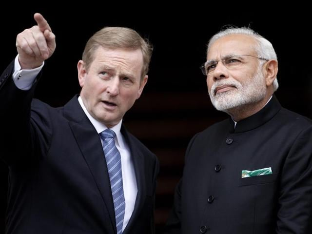 Irish Prime Minister Enda Kenny, left, points as he meets with Indian Prime Minister Narendra Modi at Government Buildings, Dublin, Ireland, Wednesday. Modi arrived in Ireland for high level talks focusing on strengthening economic, trade and investment between