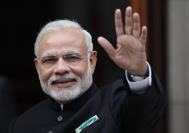 PM Narendra Modi waves as he arrives for a meeting in Ireland. Modi will meet the leaders of the tech giants Facebook, Google, Tesla and Microsoft during his visit to the Silicon Valley.(AP)