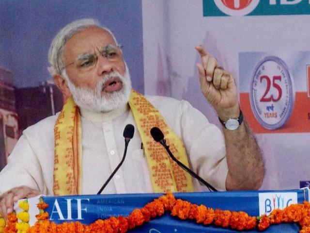 Prime Minister Narendra Modi speaks at a function in Varanasi.