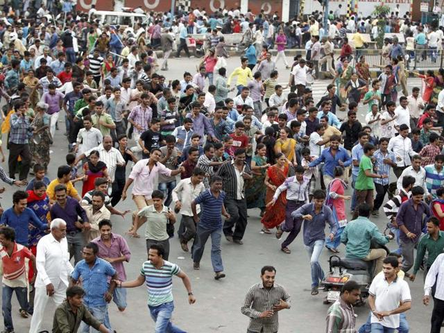 A demonstration by the Patel community for reservation is broken by the police in Ahmedabad.