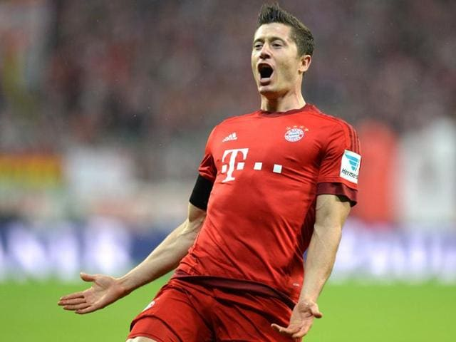 Bayern Munich's Polish striker Robert Lewandowski celebrates after the third goal for Munich during the Bundesliga match vs VfL Wolfsburg in Munich, on September 22, 2015.