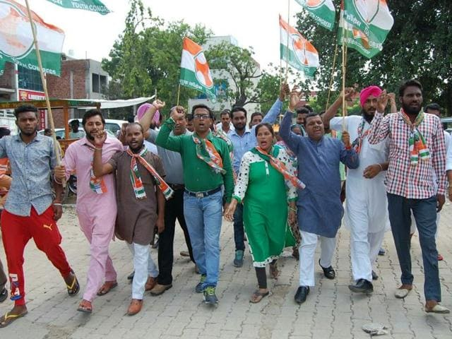 Congress workers protesting in front of the post office in Sangrur on Thursday.