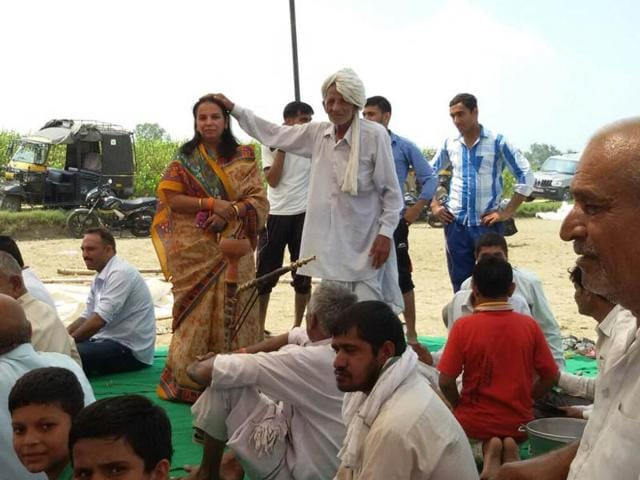 A zila parishad candidate during her election campaign in Rohtak.