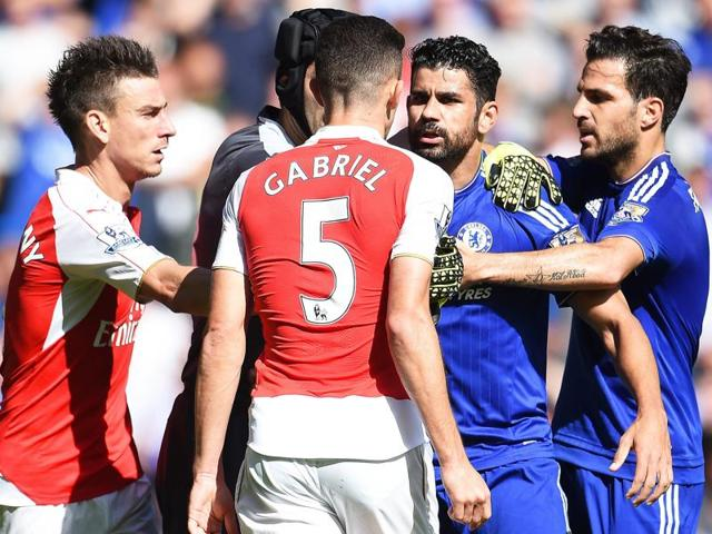 Chelsea's Diego Costa, second from right, clashes with Arsenal's Gabriel Paulista, centre, resulting in Gabriel being sent off during the EPL match at Stamford Bridge , London, on September 19, 2015.