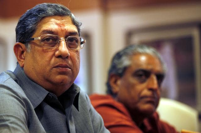 Former Board of Control for Cricket in India (BCCI) President N. Srinivasan (C) speaks as secretary Sanjay Jagdale watches during a news conference at their head office in Mumbai.