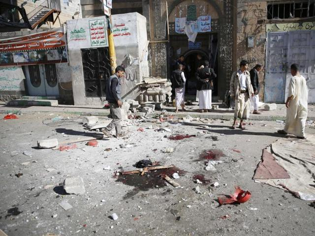 Shiite Houthi fighters inspect the scene at the al-Balili mosque after two suicide bombings at the mosque during Eid al-Adha prayers in Sanaa, Yemen, Thursday, Sept. 24, 2015.