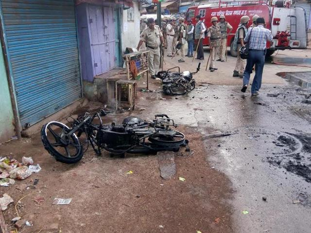 Motorcycles set on fire during clash in Imlipura area in Khandwa on Thursday. (HT Photo)