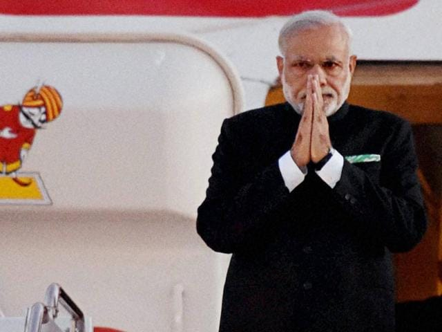 Prime Minister Narendra Modi gestures upon his arrival at John F Kennedy International Airport in New York .