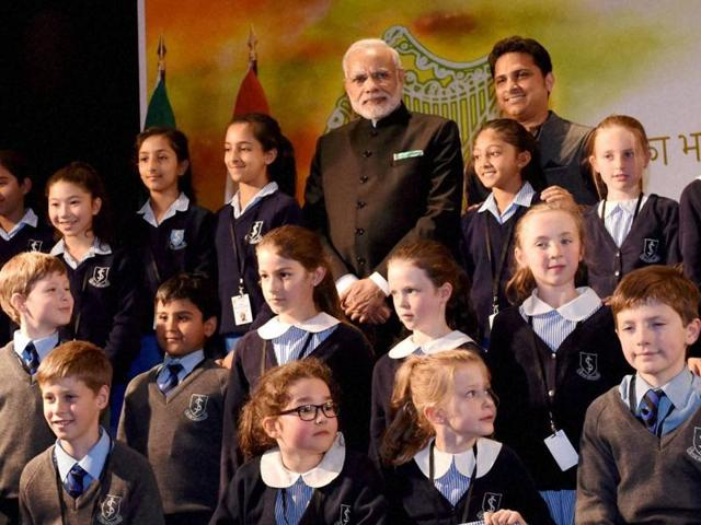 Prime Minister Narendra Modi in a group photo with the children who performed during his interaction with the Indian community in Dublin.