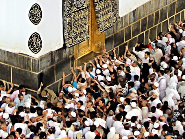 Muslim pilgrims touch the Kaaba door as they circumvent around it at the Masjid al-Haram Mosque, Islam's holiest site, two days before the Haj pilgrimage, in Mecca.