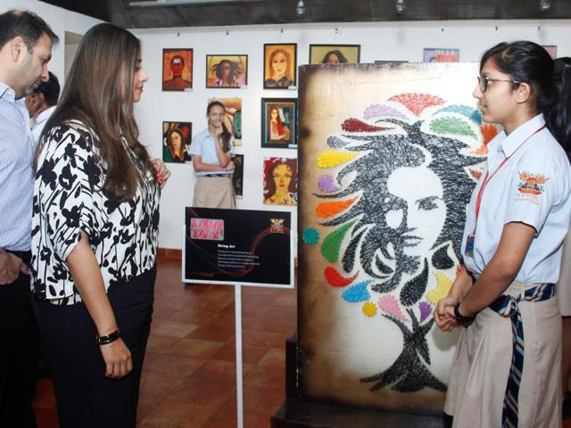A DY Patil International student's painting, which earned the highest bid at an art exhibition.