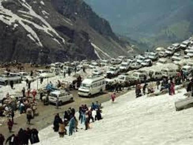 Tourists enjoying fresh snow at Rohtang Pass near Manali