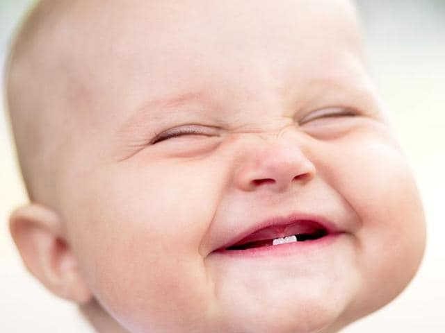 Babies often smile with a goal in mind: to make the person they are with smile in return, according to a new study.