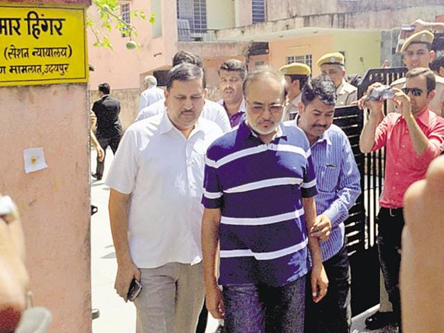 Accused in the mines bribery case, Ashok Singhvi (centre) comes out of a court in Udaipur on Thursday.