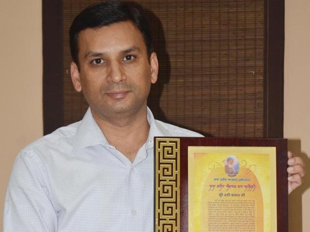 """""""I believe that honesty is just not a virtue but a way of life,"""" Bhagat said after receiving the award."""