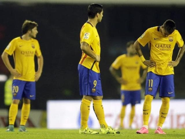 Barcelona's Sergio Carnicer (20), Luis Suarez (9) and Neymar da Silva (11) react after a goal by Celta Vigo during their La Liga match at Balaidos stadium in Vigo, Spain, on September 23, 2015.