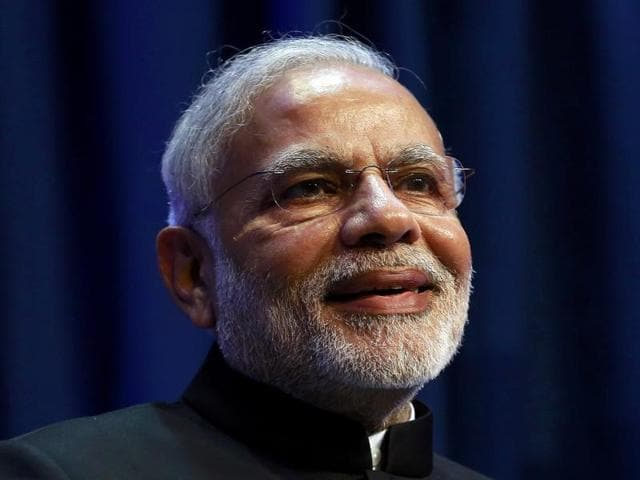 Prime Minister Narendra Modi poses before a meeting with officials of top Financial institutions in New York on Thursday.