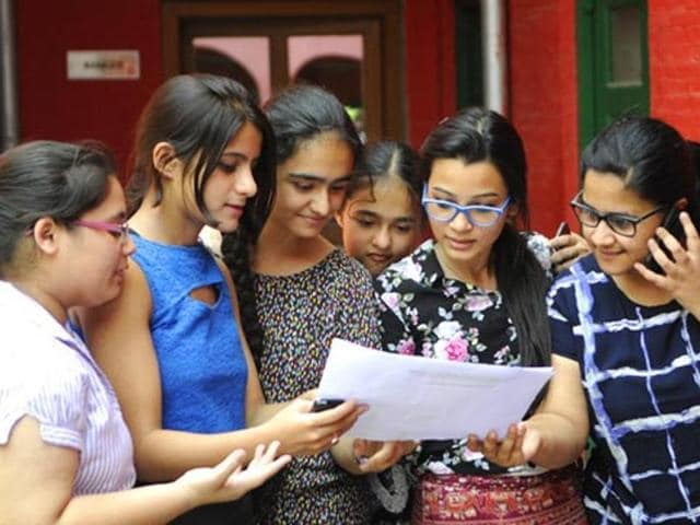 Students in a Jubilant mood after the CBSE exam results for Class 12 were announced, in New Delhi.