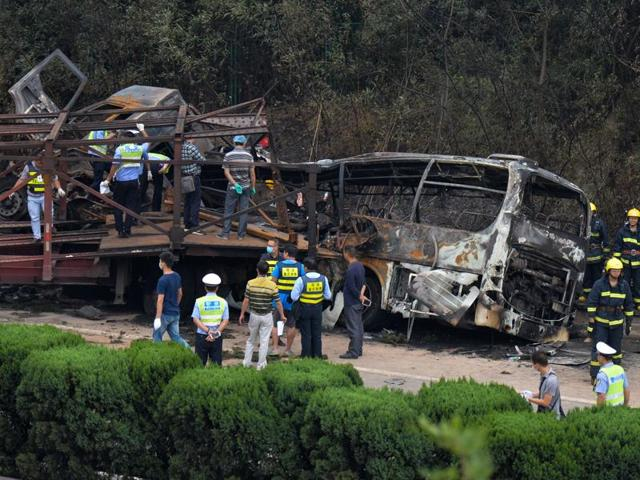 In this photo provided by China's Xinhua News Agency, rescuers work at the site of a highway accident in central China's Hunan Province, Friday.