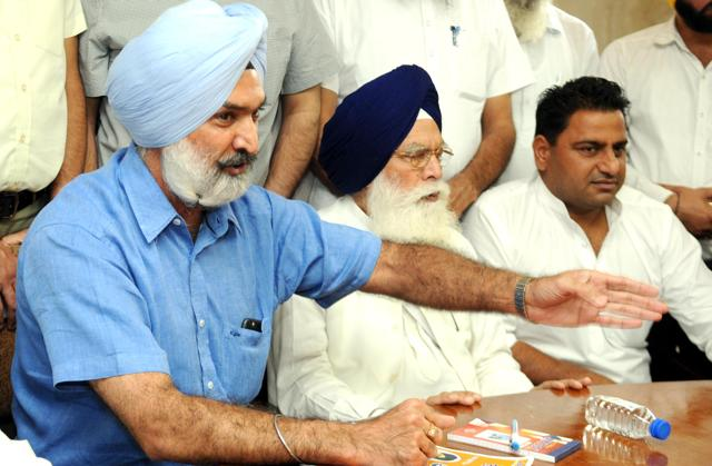 SAD Leader Deepinder Singh Dhillon addressing the worker meeting in  Patiala on Friday.