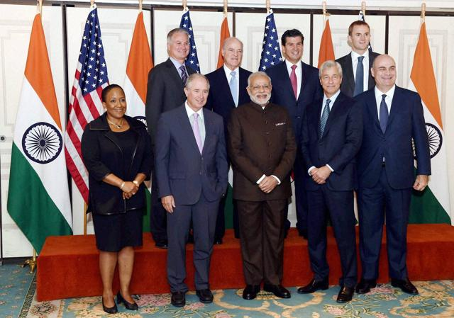 New York : Prime Minister Narendra Modi with Media titan Rupert Murdoch pose for a group picture before a roundtable meeting on