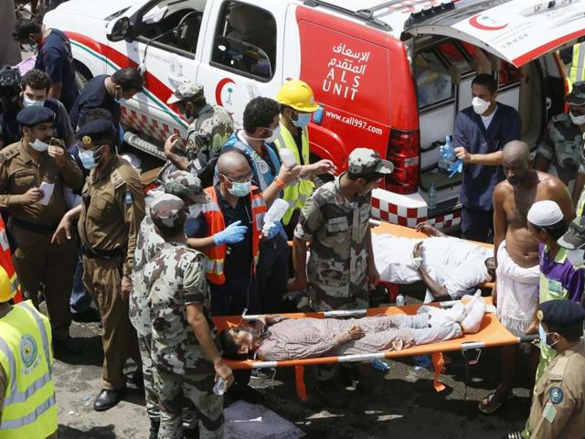 Emergency services attend to victims crushed in a crowd in Mina, Saudi Arabia during the annual hajj pilgrimage on Thursday.