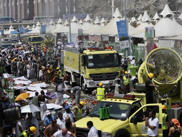 Saudi emergency services move among the bodies of the pilgrims killed in the stampede in Mecca. These pilgrims were in Mina near the holy city of Mecca in Saudi Arabia to observe one of the stages of haj.