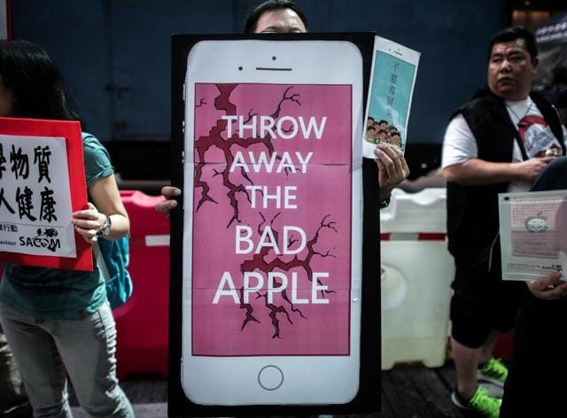 Rights campaigners stage a protest coinciding with the launch of the new iPhone 6s outside an Apple store in Hong Kong on September 25, 2015.