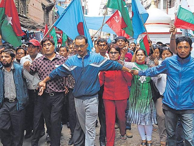 Nepalese protesters shout anti-government slogans at a protest against the constitution in Kathmandu.