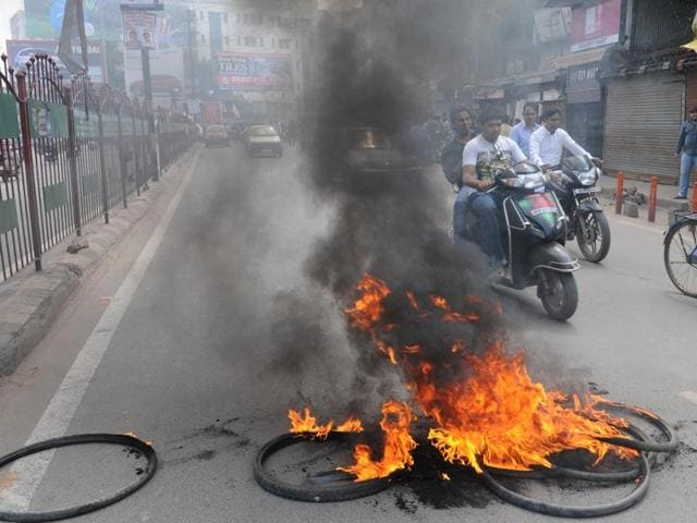 Tyres being burnt to block a road in Ranchi.