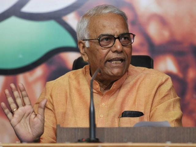 Senior BJP leader and former finance minister Yashwant Sinha addresses a press conference on the economic issue at BJP HQ Office on March 30, 2014 in New Delhi, India.